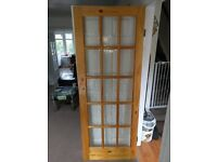 Internal pine glazed door with hinges and latch.