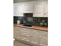 Ivory MAGNET Fitted Kitchen in good condition. Includes cooker hood, hob and brown working surfaces.