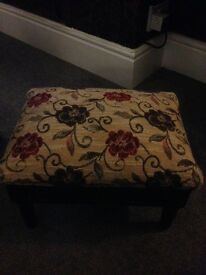 A very nice vintage looking foot stool that has storage
