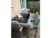 Solid wood & glass garden dining table & chairs,with seat pads. Must sell due to house move.