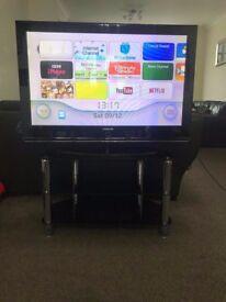 "Samsung PS42Q97HD 42"" plasma TV and Glass TV stand"