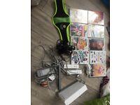 Wii + games, belt + 2 mics.