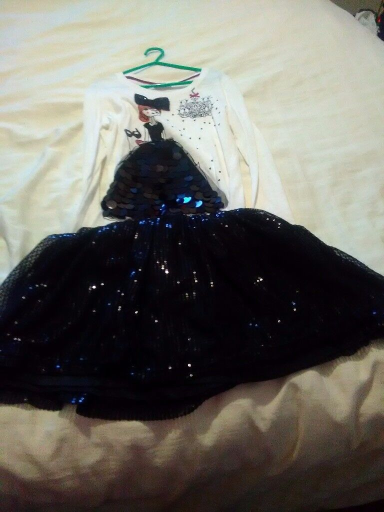Girls sequence cream/black top with matching black sequence skirt size 10 years