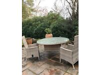Round table with separate glass top with 6 chairs. They come with cushion pads and a parasol.