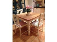 Lovely shabby chic oak table and chairs.