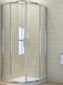 1000x900 shower enclosure, stone tray and riser kit.