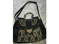 black and nude lace bag