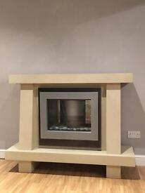 Odyssey electric fire and fireplace.