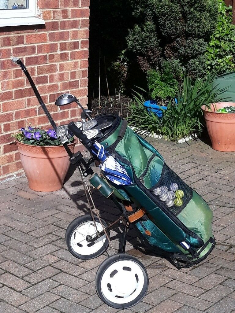 Compete set of clubs c/w bag, trolley, balls, tees etc.