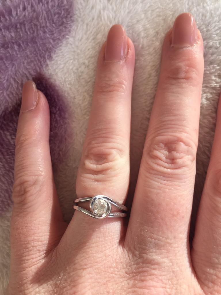 White gold diamond solitaire ring 'loves embrace'