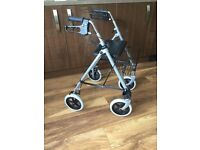 4 wheel walking aid with basket and seat.