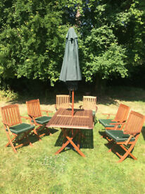 Beautiful Teak Garden table and 6 chairs with cushions plus parasol - £325