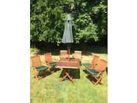 Beautiful Teak Garden table and 6 chairs with cushions plus parasol - £225