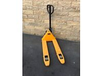 Very good condition yellow pallet truck cost £500 when new