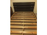 Wooden double bed frame at a bargain price