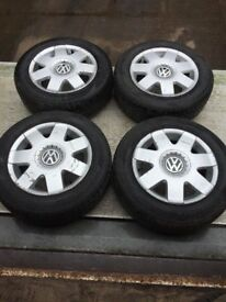 set of 4 Volkswagen polo alloy wheels with 3 good tyres