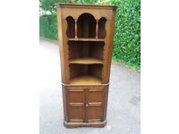 Dark wood corner display cabinet