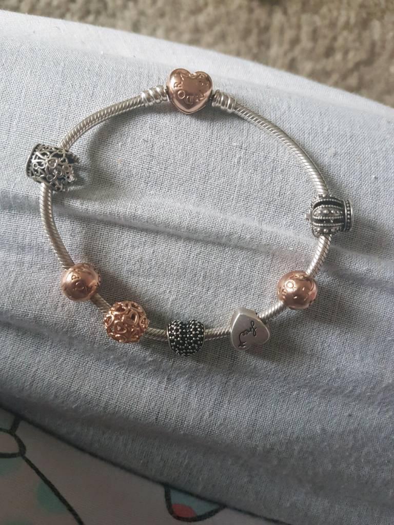 Rose gold pandora baraclet and charms