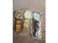 3 watches for sale 2 gold , 1 black