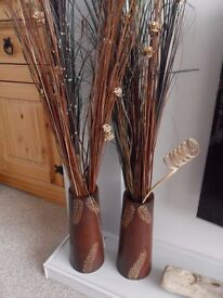 pair of vases with grass reeds
