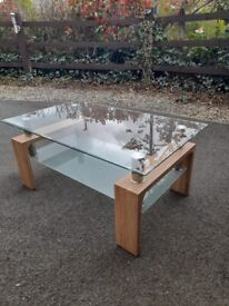 coffee table heavy, thick glass + light coloured wood