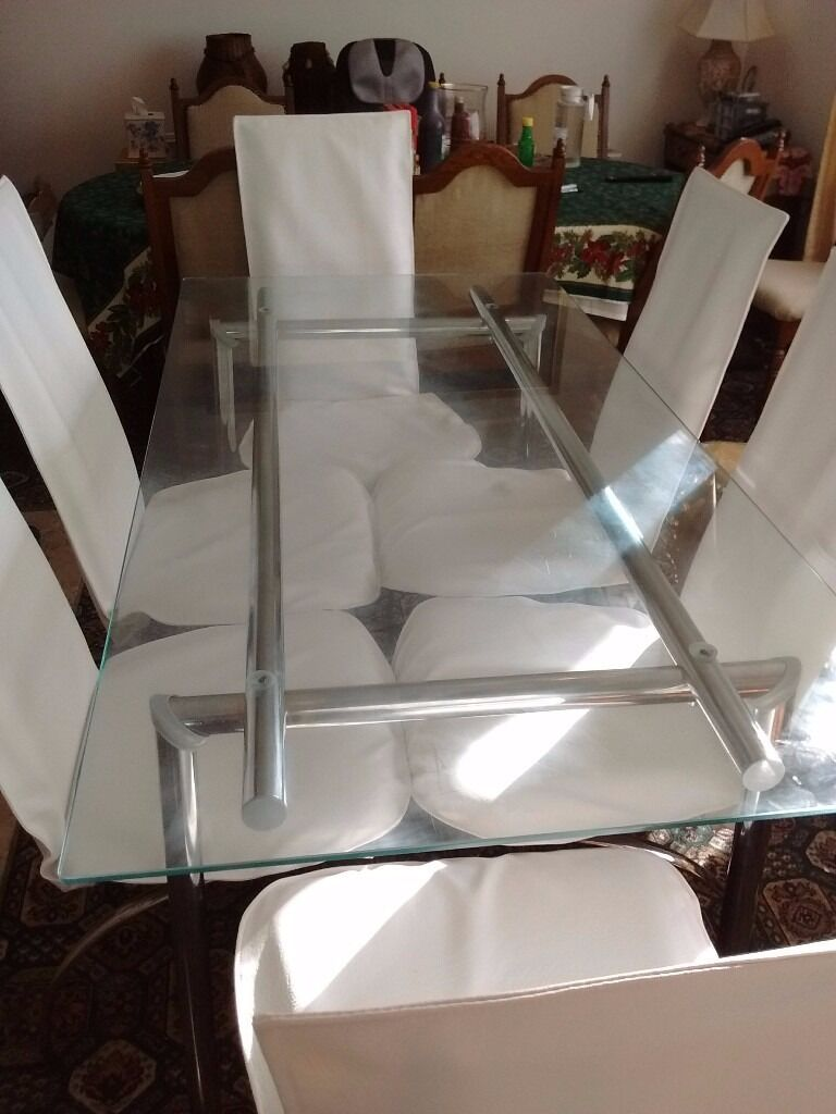 Dining Table and 6 cream leather chairsin Bournemouth, DorsetGumtree - Glass and Chrome Dining table plus 6 cream high back leather chairs. Chairs newly upholstered with German Cream leather. Redecorating reasons for the sale. Kindly call 07726632628 for more details