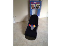 Babybjorn bouncer with wooden toys