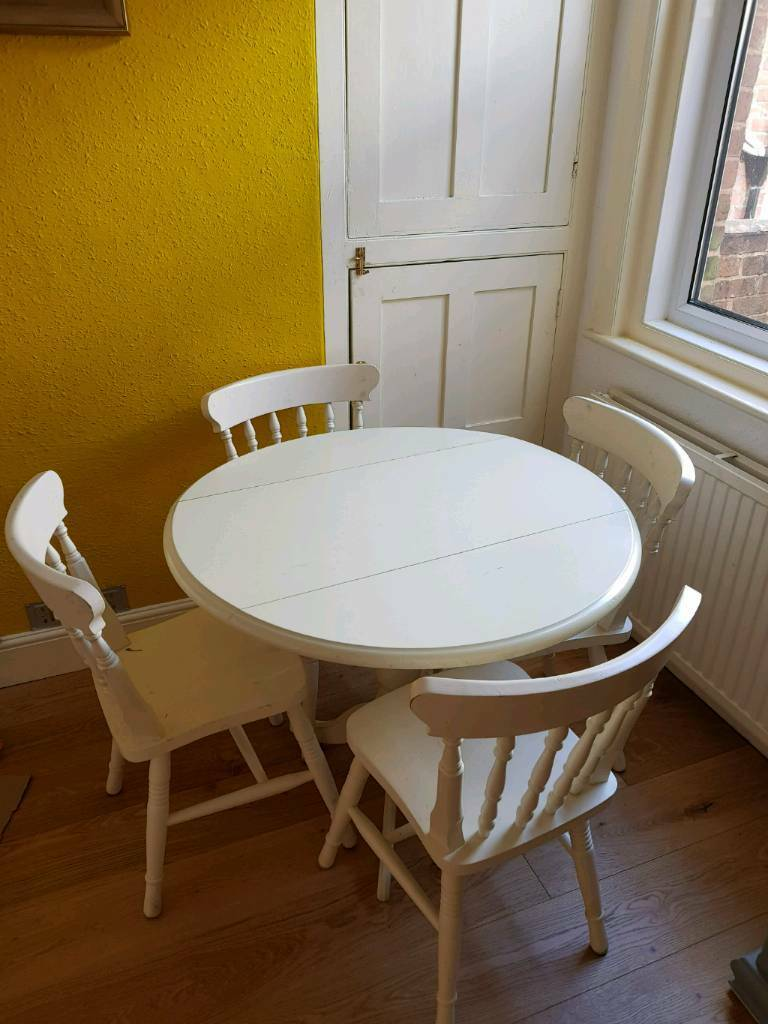 Lovely Solid Wood Round Dining Table With Folding Sides In Exeter