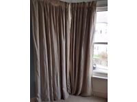 Four beige curtains with blackout backing