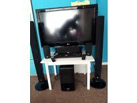 LG Flatscreen television with home cinema surround sound system