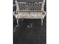 Wrought iron bench and rocking chair