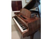 Challen baby grand piano finished in burr walnut.
