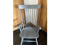Grey high back rocking chair
