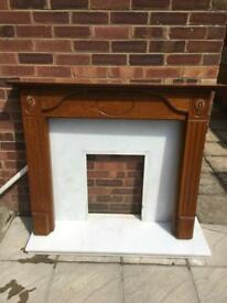 Marble fireplace with wooden surround