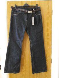 New/unworn (with tags) dark blue M&S portfolio slim boot jeans, size 18 (RRP £29.50)