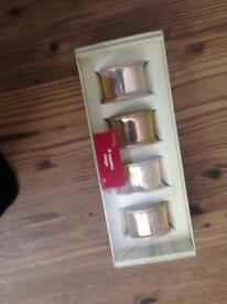 New in pack gold set of 4 napkin rings - ideal for x-mas!