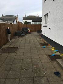 Free paving slabs for anyone willing to uplift