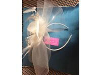 Two cream fascinators