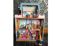 Dolls house and wooden furniture