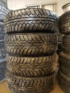 205 65 15 STUDDED WINTER TIRES ALMOST NEW