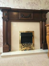 Solid dark wood traditional fireplace