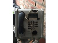 Old wall mounted pay phone