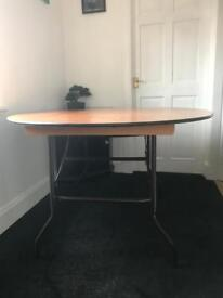 Round fold away table