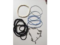 Assorted bead bracelets - blue, black, white and silver colour