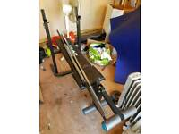 Weight lifting bench and 2 bars. Priced to clear