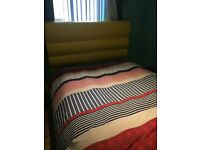 Bright yellow double TV bed frame