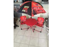 Table chairs & umbrella