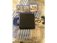 PS4 with 3 games, earphone and 2 controllers