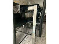 Black glass table and 6 chairs