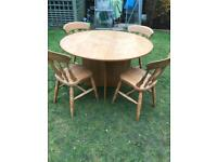 Pedestal base round table and four chairs ( can deliver)